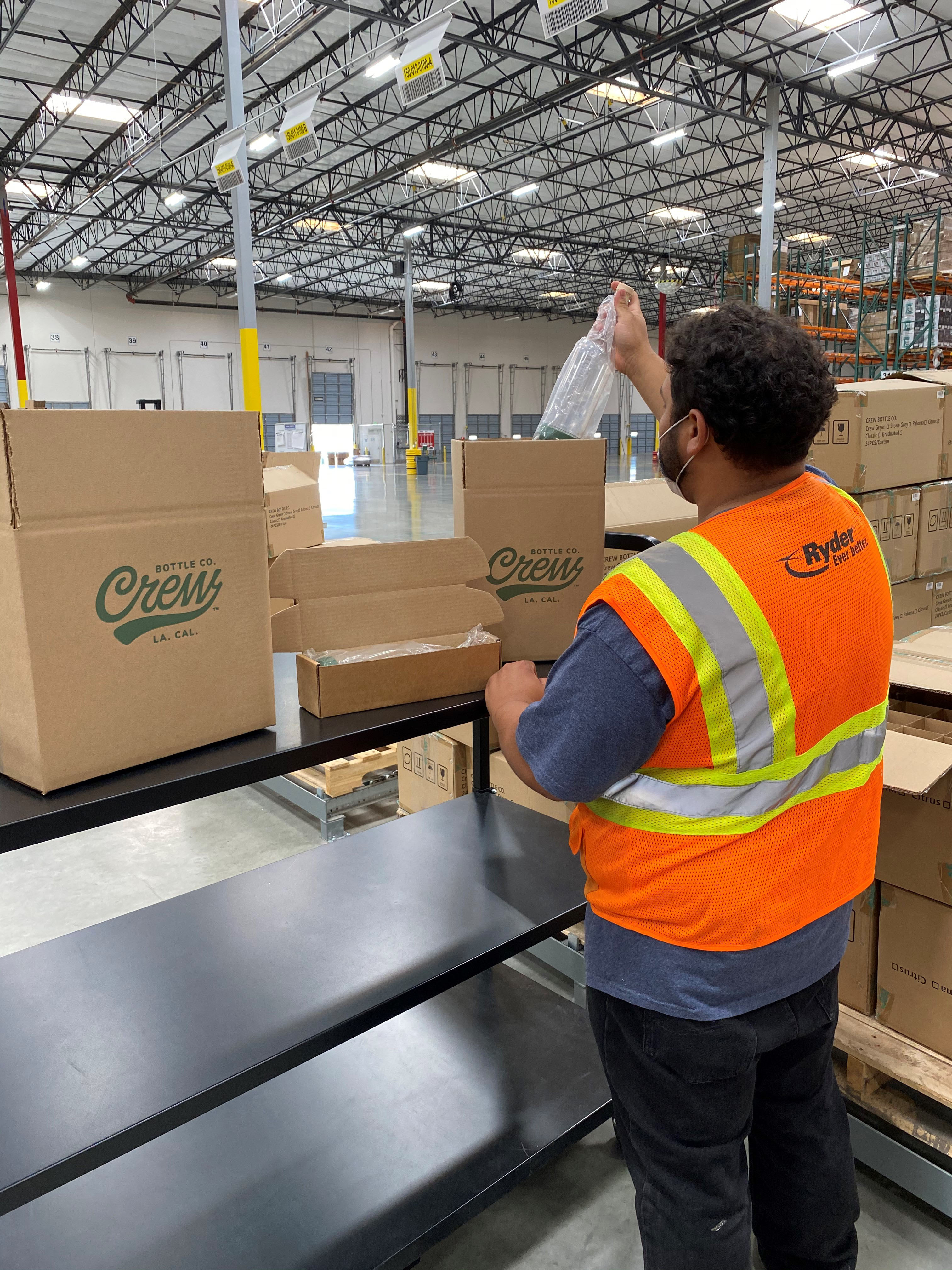 With food safety paramount to Crew Bottle Co., the company chose Ryder's FDA-certified e-commerce fulfillment facility near Los Angeles, where a Ryder employee inspects inventory inside protective wrapping. (Photo: Business Wire)