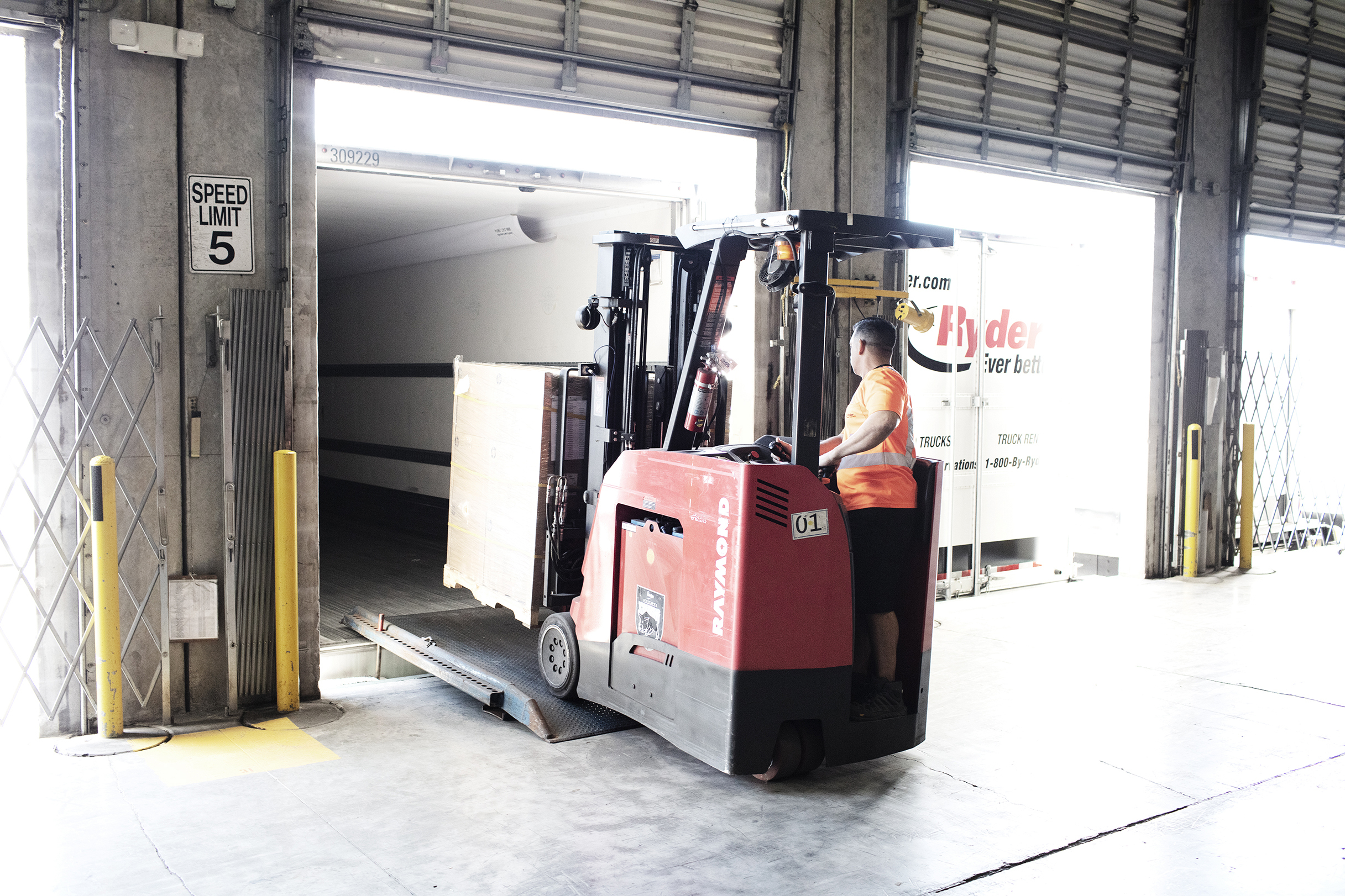 A forklift operator loads a trailer at a Ryder-managed supply chain solutions warehouse. (Photo: Business Wire)