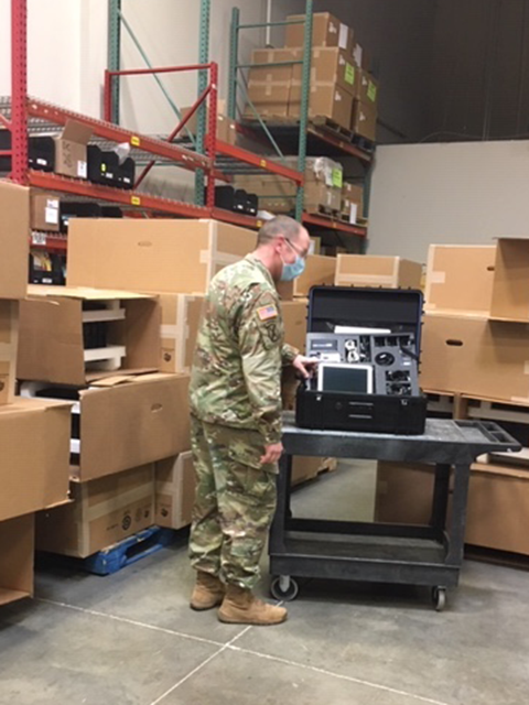 CPT Adam Hever inspects Savi Portable Deployment Kits III at FSE's Maryland location, part of a joint public-private partnership to deliver cutting-edge logistics tools to the Army National Guard